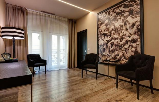 фотографии Dharma Hotel & Luxury Suites изображение №4